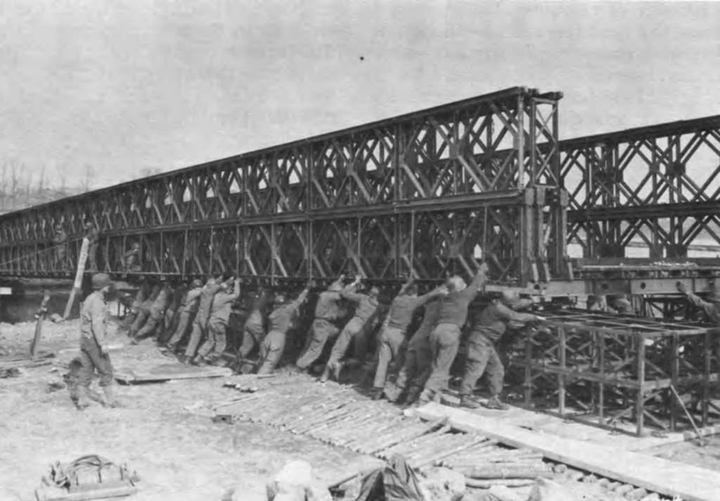 American troops building a floating Bailey Bridge, similar to the one the 148th Engineer Combat Battalion built.